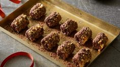 Dark chocolate, pistachio and praline truffles.