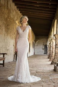Trumpet lace wedding gown with beading that cascades from the illusion bodice to the train. A V-neckline is flatterting and adds a touch of alluring look. Click the link for more info and styles.