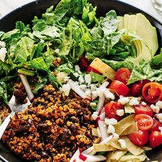 This vegetarian version of Mexican take-out taco salad contains crisp romaine and peppery arugula tossed in a creamy, intentionally zippy avocado-lime dressing. Chili-flavored quinoa, black beans and crispy tortilla strips round things out. Vegetarian Taco Salad, Taco Salads, Healthy Salad Recipes, Real Food Recipes, Healthy Snacks, Chicken Recipes, Vegan Recipes, Healthy Foods, Healthy Eating