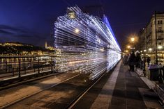 Long Exposure Photos of Budapest Trams Lit Up with 30,000 LED Lights