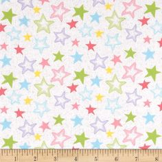 Starry Night Glitter Stars Pastels/White from @fabricdotcom  This cotton print fabric is perfect for quilting, apparel and home decor accents. Colors include pink, yellow, aqua, green and white with silver glitter accents.