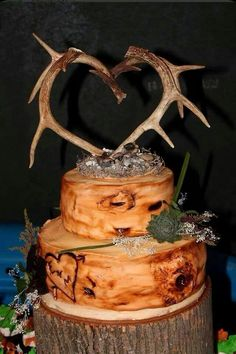 Antler topper for wedding cake. Maybe in a heart or not