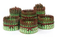Lot 508, Collections: European Decorative Arts, 17 Oct 2015, NY / Group of Dodie Thayer Pottery Asparagus-Form / Est 500-700 / SOLD $13,750