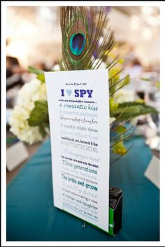 DIY I spy wedding game with disposable camera and peacock feather