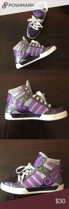 Adidas original purple and grey high tops Adidas purple and grey high tops. Good condition, hardly worn. Size 5. I wear a 6.5 and they fit. Adidas runs a size smaller than shoe size. Few marks but otherwise mint condition. Been sitting on my shoe shelf collecting dust. Adidas Shoes Sneakers