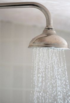Deep clean shower head After having a shower, fill a sandwich bag with baking soda and vinegar and tie it around the showerhead using an elastic band. Leave this to soak overnight then any debris will come off easily with an old toothbrush. 14 Spring-Cleaning Hacks