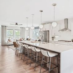 Sleek, bright and airy, this open concept kitchen with a waterfall island and modern touches is perfect for wowing family and friends.