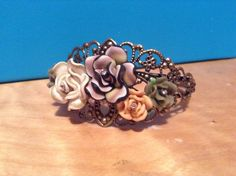 Bronze filigree bangle bracelet with polymer clay flowers