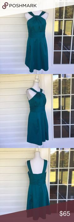 Davids Bridal Teal Halter Neck Bridesmaid Dress With a flared skirt, this half halter dress is ideal to wear to your next big event. Made from cotton with a poly lining, this dress is a lovely piece. In good condition. Approximate measurments lying flat: 17.5' bust, 15' waist 30418 David's Bridal Dresses Wedding