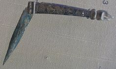 A Viking-era folding knife with bronze handle.