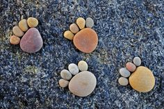 Paw Prints by Iain Blake  Most awesome creative photography using stones (12 photos) | buZzhunt.co.uk