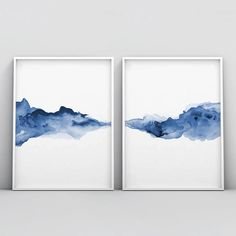 Abstract, liquid, and dissolving forms harmonized in minimalist fashion form a horizontal line on this 2 piece poster set. Watercolor technique supports different shades of blue color, leaving the impression of sensitivity and subtlety. Blue is the color of the spirit and has a positive effect on the mind and body. Wit