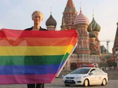 tilda swinton risks arrest by waving rainbow flag in Red Square, July 3