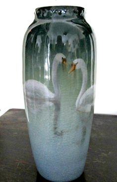 Tall Rookwood iris glazed vase with decoration of a pair of swans. Cincinnati, Ohio. Decorated by Carl Schmidt. Dated 1905.