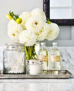 A simple silver tray organizes bath accessories so beautifully!