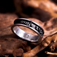 """Diligo Ergo Sum Ring Silver (narrow) - A Symbol of our great love. The """"Diligo ergo sum"""" ring is a revision of the famous quote from the well-known philosopher, Descartes, who declared """"I think therefore I am"""".  Descartes was trying to logically prove his existence.  The popular phrase is also well known in it's Latin rendition – """"Cogito ergo sum"""".   In this ring the phrase was modified from a mere logical claim to a statement that sums up the essence of the entire creation – """"I love ..."""