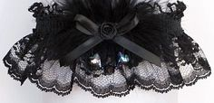 A Dash of Enchantment. Black lace garter with black Aurora Borealis hearts and marabou feathers. A black Garter for wedding - bridal - prom - fashion. Style #FM-1C / Visit: www.garters.com/page31e.htm