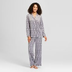 Bring your day to a close in head-to-toe comfort with the Sueded-Microfleece Notch-Collar 2-piece Pajama Set from Laura Ashley. You'll love to snuggle into soft microfleece, and the fit of a collared button-down shirt makes for a bundled-up feel. Fleece pajama pants match your top and offer a relaxed, comfortable fit. Whether you cozy up in bed to watch your favorite TV show or simmer down with a cup of tea, you'll be undeniably comfy in this fleece pajama set.