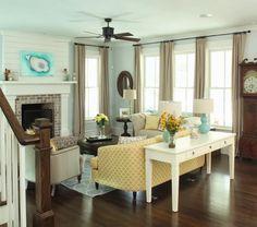 Flatfish Island Designs...love the planks over the fireplace