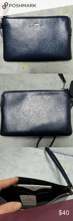 NWT Coach small wristlet in metallic midnight. NWT coach small wristlet in metallic midnight. Tag is not attached, but it is inside. 2 credit card slots inside. 6 x 4. Tiny white mark in upper left corner on the back. Barely noticeable. Might buff out. Coach Bags Clutches & Wristlets