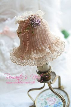 romantic  lamba- lovely lampshade decoration. Not sure if it could be used on an actual lamp but it would be pretty on a dressing table.