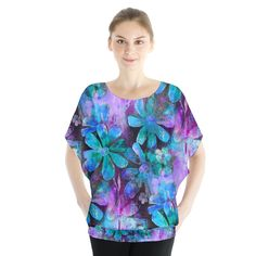 Blue on Purple Vintage Flowers. Blue on Purple Vintage Flowers Blouse Batwing Chiffon Blouse.  Get that gentle billow look with this chiffon blouse complete with a batwing sleeve cutting! Great casual look for the spring and summer when matched with shorts and a pair of sandals.      Made from 100% Polyester Light chiffon semi-sheer material with white underlayer Fully customizable Hand wash in cold water only Designs imprinted using an advance heat sublimation technique