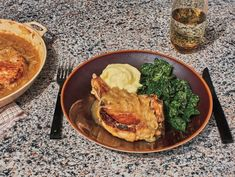 Pork Chops With Onion Gravy Recipe - NYT Cooking Pork Recipes, New Recipes, Cooking Recipes, Favorite Recipes, Tender Pork Chops, Baked Pork Chops, New York Times Cooking, Sauteed Greens, Onion Gravy