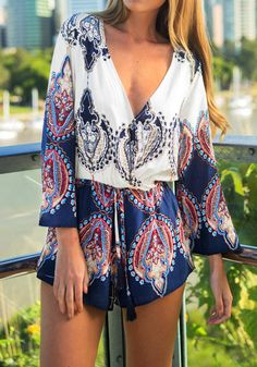 Take your party look to the next level with this baroque print plunge romper. It features flared sleeves and plunging neckline that can add a sexy and dramatic factor to your summer attire.   Lookbook Store Jumpsuits and Rompers