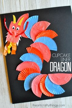 This cupcake liner dragon craft makes a great Chinese New Year craft for kids. Y… This cupcake liner dragon craft makes a great Chinese New Year craft for kids. You could also use it as an alphabet craft for the letter D. Chinese New Year Crafts For Kids, Chinese New Year Activities, Chinese Crafts, Chinese New Year Decorations, New Years Activities, Art Activities, Art For Kids, Chinese New Year Dragon, China For Kids