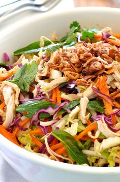 Crunchy cabbage, carrots, and shredded chicken are tossed with fresh herbs and a fabulous Asian dressing.