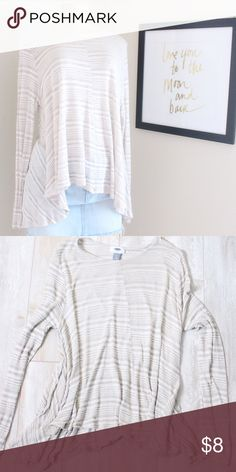 Old Navy High low Blouse Old navy high low Blouse in color cream, very flattering as it is snug around arms and chest and loose around hem, measurements laying are arm pit to arm pit 22'  length from shoulder to lowest part of hem 26'⭐️Bundle&Save⭐️ Old Navy Tops Blouses