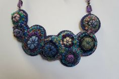 Fish Eye Rugs hooked jewelry.  Lots more on the web site