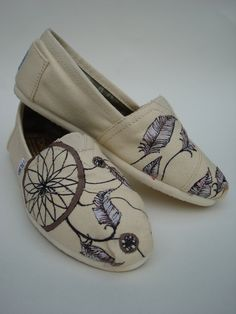 Dream catchers -all natural- hand painted on TOMS shoes-made to order. $130.00, via Etsy.