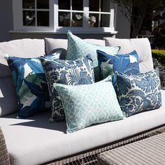 Blue, white & aqua outdoor cushions on lounge.