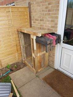 Pallet log shed with Welly Rack