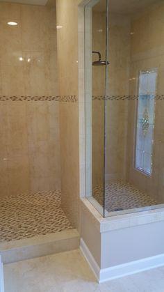 Master Bathroom Walk-in Shower - 12x24 Porcelain tile on the shower walls and mosaic tile on the shower floor.