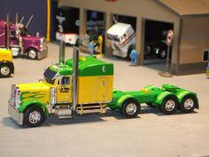 coustommack trucks | ... Truck Mack And Green And Black Mack With Lowboy in 1/34th Scale Trucks