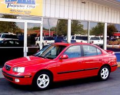 This was the car I traded in to get The Baby Tank.  2003 Hyundai Elantra GT. Sunroof, sport suspension, alloy wheels, 5-speed, bought it brandy-new. Never did give her a name, but I sure did love that car.