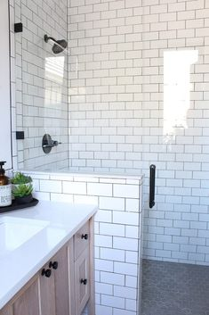 The House of Silver Lining: A Classic White Subway Tile Bathroom Designed By Our Teenage Son! The House of Silver Lining: A Classic White Subway Tile Bathroom Designed By Our Teenage Son! White Subway Tile Bathroom, White Tiles, Subway Tile In Shower, White Tile Bathrooms, Dark Floor Bathroom, Navy Bathroom, Dyi Bathroom, Bathroom Inspo, Budget Bathroom