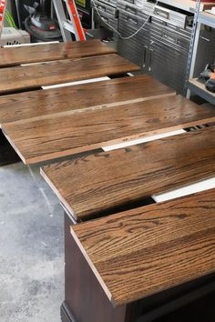 A picture of the stair treads with the first coat of polyurethane.