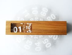 'time frame' wall clock sold by northern line tells time via two revolving discs