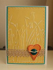 hanmade card ...  Cuttlebug embossing folder grasses and bird ... light sanding of Core'dinations paper ... lovely card ... like how the turquoise mat holds the yellow main panel  in ...