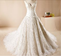 http://pt.aliexpress.com/item/2015-handmade-luxury-palace-diamond-super-luxury-long-trailing-wedding-dress/32289168538.html?recommendVersion=1