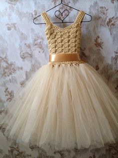 Gold flower girl tutu dress ankle length tutu dress Boho by What if a mini version could be done for a barbie? Love this tulle skirt--- a lovely flower girl dress for a romantic vintage wedding! Maybe with a navy sash? This would be beautiful life sized! Girls Tutu Dresses, Tutus For Girls, Little Girl Dresses, Flower Girls, Flower Girl Tutu, Gold Flower Girl Dresses, Gold Dress, Crochet Tutu Dress, Crochet Barbie Clothes