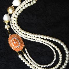 Orange pachi piece with faux pearl neackpiece