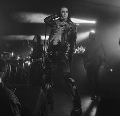 Motionless In White on stage<<< Okay he looks like he's having a sassy goth competition
