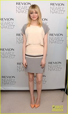 Emma Stone in Daniel Vosovic dress - Revlon's New Nearly Naked Makeup Launch held at The London Hotel in New York City.  (December 5, 2012)