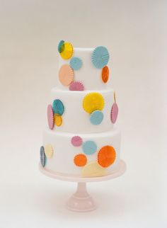 playful wedding cake with colored pinwheels :: Mindy Weiss Wedding + Elizabeth Messina Photography