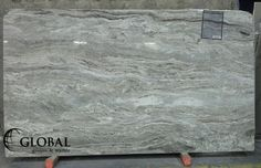 Fantasy Brown polished quartzite. Visit globalgranite.com for your natural stone needs.
