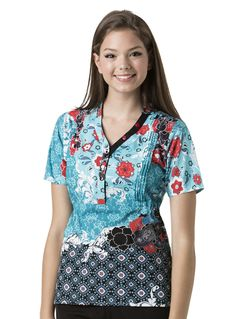 "Santa Fe - 6647 STF-6647 - WonderWink Button Front Print (""Lady"" Fit) • Mandarin collar with both decorative and functional buttons down the placket • Vertical pin tucks at front bust for design detail • Elastic at side waists adds a feminine fit detail and gives a nice cinched look while providing ultimate comfort • Two front roomy invisible pockets and side vents  Available at Scrubs & More, The Uniform Store ."